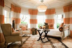 I love the orange stripe curtains and the roundness of the room, very plush. Love everything but the rug  Lounge