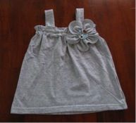 t-shirt upcycle. I love these old t-shirt projects. I might be able to use one shirt for both girls :)
