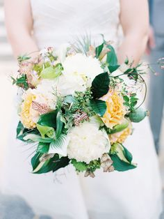 Pretty combination of Flowers in this Wedding Bouquet! See more on SMP: http://www.StyleMePretty.com/2014/04/02/sweet-whimsical-wedding-on-lake-geneva/  MomokoPhotography.com/