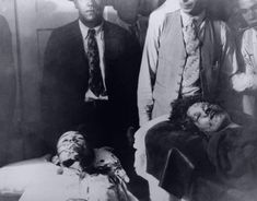 The bodies of Bonnie Parker and Clyde Barrow as they were first brought in to the coroner's office, which was in the back of a furniture store