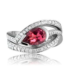This gorgeous pavé set tailored ring is designed to fit beautifully with Simon Pure's striking pink tourmaline 'Satellite' ring. This versatile design can be worn either side of the ring to create your preferred look.