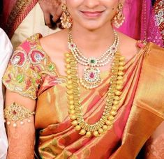 South Indian bride wearing traditional antique mango mala with white and colored kundan stones studded on the top of the long chain. Laks...