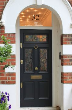 Edwardian front door with leaded light. Great light idea in vestibule. #exteriordoorstyles