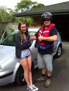 Dad tells daughter how terrible she is at driving. Daughter puts on teenage face and crosses arms. Because she's cool.