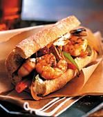 Blackened Shrimp Po' Boy    1	lb	large raw fresh shrimp, peeled and deveined  1	T	Cajun blackened seasoning for seafood  1⁄4	c	plus 2 tbsp low-fat mayonnaise  2	T	Dijon mustard  2	T	lime juice  4	 	6-inch whole-wheat submarine rolls  1	T	plus 1 tsp butter or margarine, divided  2	 	medium green or red bell peppers, thinly-sliced  2	clv	garlic, minced  instructions    Toss the shrimp and Cajun seasoning in a small bowl. Cover with plastic wrap and refrigerate for 30 minutes to 1 hour.