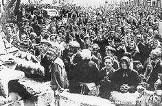 """Local Ukrainians in Lvov welcoming the German army in July 1941. Lvov had been a center of nationalist conflicts between Germans, Poles and Ukrainians. When units of the Ukrainian nationalist leader Stefan Bandera joined the German forces in the war against the Soviet Union, they also joined in the killing of Jews. In July alone, more than 2,000 Jews in Lvov fell victim to """"action Petlyura"""" - named in honor of the Ukrainian anti-Bolshevist leader."""