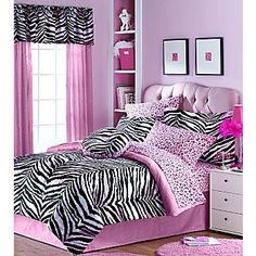at 16 i had a waterbed with a very grown up motif in my room. at 40, i want my 16-year-old zebra and pink bedroom. i'm sooooo backwards.