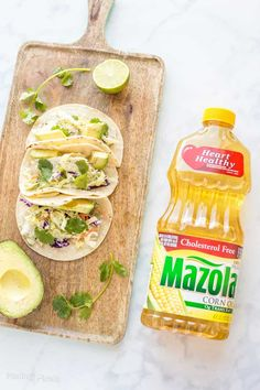 Baked Fish Tacos are an easy, healthy taco recipe that's ready in less than 20 minutes. Made with baked fish, coleslaw veggies and a homemade cilantro lime dressing. With Mazola Corn Oil. Baked Fish Tacos, Healthy Fish Tacos, Healthy Taco Recipes, Baked Fish Fillet, Best Seafood Recipes, Mexican Food Recipes, Ethnic Recipes, Delicious Recipes, Cilantro Dressing
