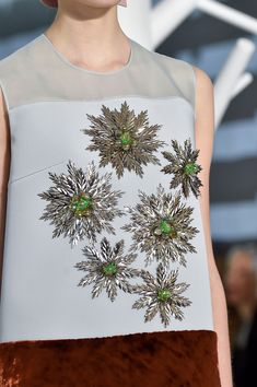 #Delpozo Fall 2015 Runway #embroidery #embellishment Reminds me of a cross between snowflakes and Ninja stars