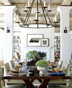 Farmhouse Table, Comfortable Understated Chairs, Rustic Ceiling Beams, Crisp White Paint with Black Iron Lighting ~ Urns of Hydrangea via www.elementsofstyleblog.com