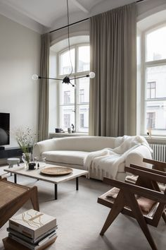 Warm and inviting living room with white couch and large windows