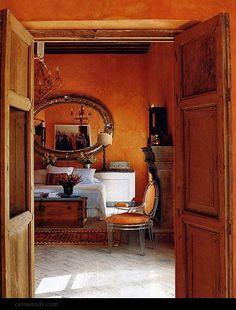 Mottled orange walls and orange chair.  Splendid Sass