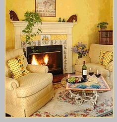 Love the cozy and comfy chairs by the fireplace with the small table... perfect for tea & crumpets in the morning or wine & nibbles at night!