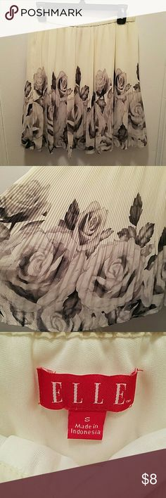 Pleated Skirt Black and grey roses printed on a cream pleated skirt.  Light, airy fabric. Elastic waistband ensures a comfortable fit. Elle Skirts