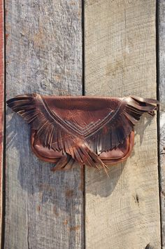 Fringed leather clutch.