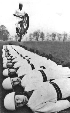 Sergeant Major Tom Gledhill leaps over 20 members of the Royal Artillery on his BSA A50 twin motorcycle.  March, 1966.