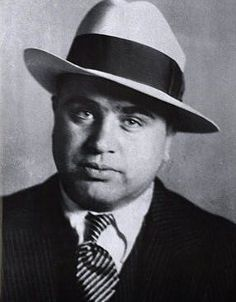 """Alphonse Gabriel """"Al"""" Capone,1/17/1899 – 1/25/1947, was an American gangster who led a Prohibition-era crime syndicate. The Chicago Outfit, which subsequently also became known as the """"Capones"""", was dedicated to smuggling and bootlegging liquor, and other illegal activities such as prostitution, in Chicago from the early 1920s to 1931."""