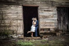 Stealing kisses in the rustic stables at Gabbinbar Homestead. Photo by AA Photography Wedding.