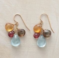 HAPPENSTANCE EARRINGS--Artist Thoi Vo lets serendipity lead the way in placing an array of faceted gems—hessonite garnet, aquamarine, pink tourmaline, and andalucite