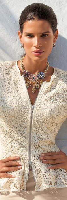 Crochet lace zipper top with a big floral necklace.  Women's spring fashion