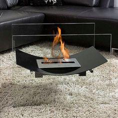 A striking design that appears to float above the ground, the Veniz Fireplace from Bio-Blaze is a fireplace created for indoor and outdoor decoration. With one bio ethanol burner cradled by a gently curved sheet of steel, this fireplace requires no instal Floating Fireplace, Modern Fireplace, Fireplace Design, Fireplace Glass, Tabletop Fireplaces, Ethanol Fireplace, Interior And Exterior, Interior Design, Fireplace Accessories