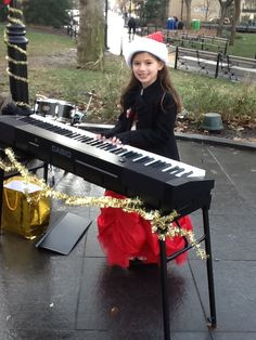 Mini Maestros students play and sing holiday music in Washington Square Park!