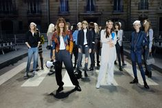 A rehearsal for the Chanel show, featuring Caroline de Maigret with her megaphone. Photo: Louise Parker