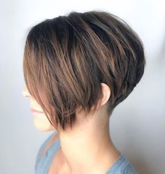 Tapered Pixie with Long Side Bangs This pixie haircut is short in the back, with a lot of volume on top, and you have long bangs to play with. Keep them straight or use a conical iron to shape some easy curls. This way you'll get a romantic look, perfe Bobs For Thin Hair, Short Hairstyles For Thick Hair, Haircut For Thick Hair, Very Short Hair, Short Hair With Layers, Short Pixie Haircuts, Pixie Hairstyles, Short Hair Cuts, Curly Hair Styles