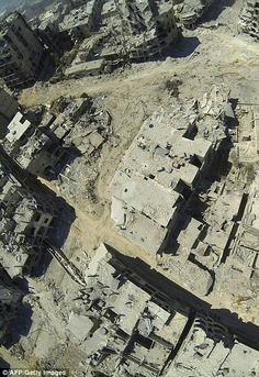 http://www.dailymail.co.uk/news/article-2380913/Syria-Homs-aerial-pictures-scale-destruction.html
