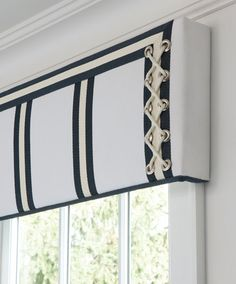 Details definitely do make the difference. The fun rope detail on this cornice board window treatment adds a gorgeous touch of sophistication without being overly nautical. Marianne Jones LLC Marianne Jones - Birmingham, MI