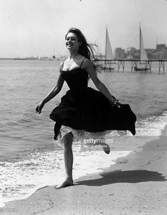 Running barefoot on the sands at Cannes, French film star, Brigitte Bardot (Camille Javal).