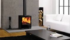 Image result for wood stove surround modern