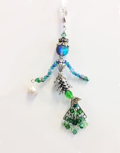 LITTLE SIDEKICKS HANDCRAFTED BY CJ STUDIO - LENORE - MERMAID JEWELRY $128.00 Little Sidekicks are tiny, whimsical, collectable, jewelry people (Bead People). Each one is unique, and they have moveable parts. Little Sidekicks can be worn as a pendant on a chain or can have a clip added to use on a handbag or clipped onto a collar. Sidekicks make a great unique gift and can be made to order with personalized colors and charms. Available at: www.littlesidekicks.com