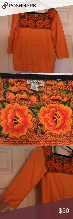 "NWOT embroidered sweatshirt NWOT rare lucky brand sweatshirt. Orange with full top panel of embroidered roses. 3/4 length sleeves. 26"" long, 21"" across armpit to armpit. Embroidered portion does not stretch. Rest of material has slight stretch. Not sure I want to let this beauty go, but I haven't worn it, so someone else should enjoy it. Can best fit medium of moderate large. Lucky Brand Sweaters"
