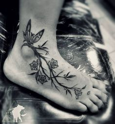 Fresh from the Web Fun foot piece.  #thanksforlooking #jonathanescoart #butterfly #butterflytattoo #butterflys #branch #branches #flowers #flower #tattoos #tattoo #black #blacktattoos #blackwork...