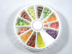 Hey, I found this really awesome Etsy listing at http://www.etsy.com/listing/94301170/fruit-slice-fimo-nail-art-wheel-cane