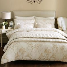 Cream and gold bed linen.  http://www.worldstores.co.uk/p/Janet_Reger_Tamsyn_Throw.htm