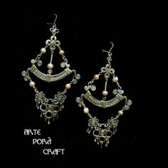 Original design, elegant, hand made, long filigree earrings with pink pearls from Ecuador . Have a lot of movement & shine with make them…