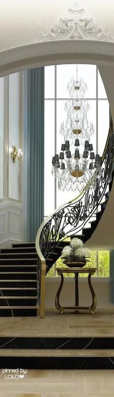 A breath-taking vertical window creates a focal point to this sweeping Staircase. Beautiful!