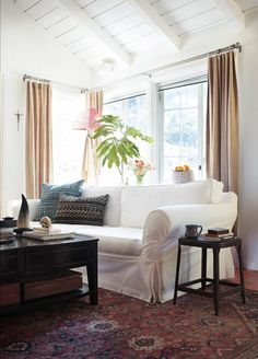 Pin for Later: This LA Cottage Makes a Case For White Walls Two new pieces that made a huge difference are the bright white sofa and coffee table. Source: Photo by Tessa Neustadt for Homepolish Living Room White, New Living Room, Interior Design Living Room, Living Room Furniture, Living Room Decor, Living Spaces, Cozy Living, Interior Decorating, White Couches