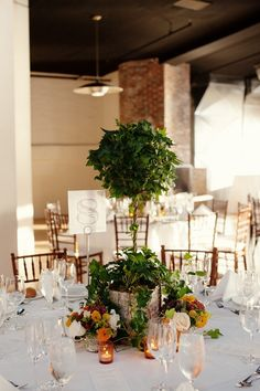 Topiary Centerpiece during the day and insert mini-lights for nighttime.