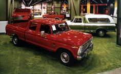 1974 Chicago Auto Show. A bright red Ford F-350 (one-ton) four-door crew-cab pickup truck, and side view of an F-350 pickup truck with windowed camper top over its bed area were featured in the Ford truck exhibit on the lower level of McCormick Place East.