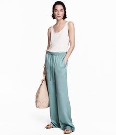 Blue-gray. Wide-cut satin pants with an elasticized drawstring waistband. Concealed side-seam pockets, mock welt back pockets, and straight legs.