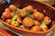 red potatoes in a clay pot