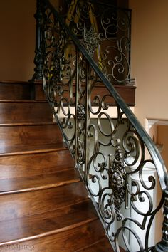 Smooth to the touch and made from hand-forged wrought iron, these interior hand railings feature custom banister posts and more Spanish scroll designs, as well as added large floral pendants. Description from demejico.com. I searched for this on bing.com/images