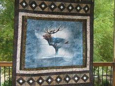 """""""Are you looking for an amazing quilt to give to that hunter in your life or for yourself? Well we just might have the quilt for you. We are offering a quilt with a elk. This quilt would look great in your man or woman cave, a cabin or just in the den. The above pictures do not due justice to this quilt. The fabric line is called Call of the Wild and offered by Hoffman Fabrics. The panel is a digital print and just amazing. If you would like to use this quilt as a wall hanging, we can add a slee Wild Bull, Wildlife Quilts, Cowboy Quilt, Bear Paw Quilt, Fabric Panel Quilts, Bull Elk, Summer Quilts, Call Of The Wild, Man Quilt"""