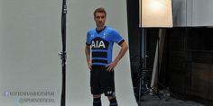 Denmark international Eriksen poses in the new navy and light blue strip which is availabl...