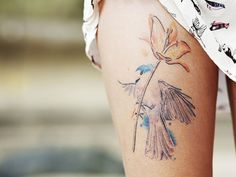 25 Exotic Thigh Tattoos For Women - SloDive