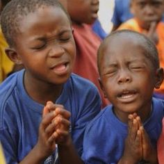 Children praying with passion