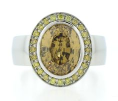 Juicy Gem Collection 14k white gold and platinum ring set with yellow diamond halo and one Golden Zircon center stone